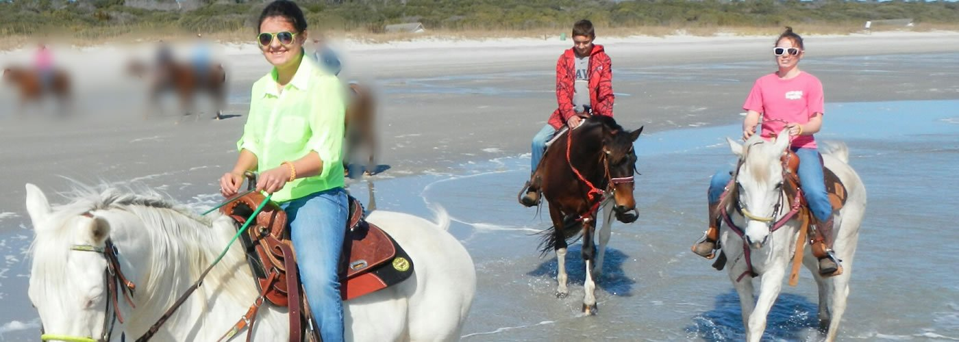 Family Horseback Riding on the Beach