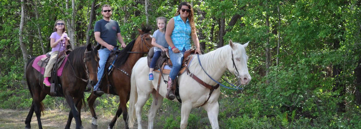 Family Horseback Riding in the Woods