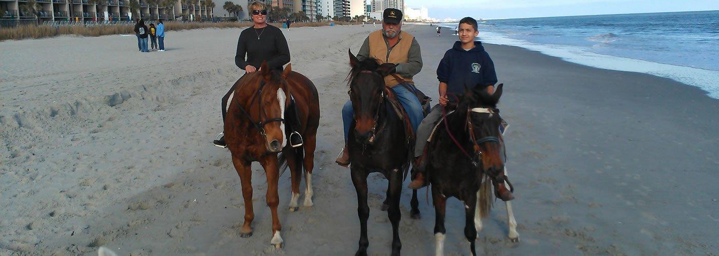 Family of 3 Horseback Riding on the Beach